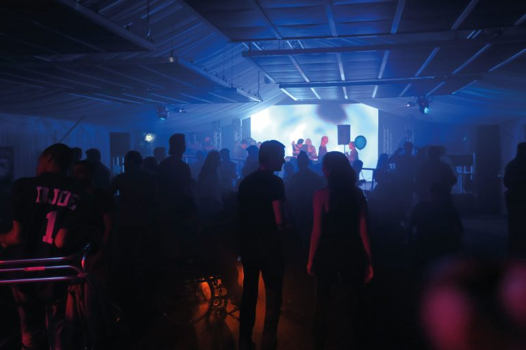 live music and crowded dancefloor with Zone Array panels overhead