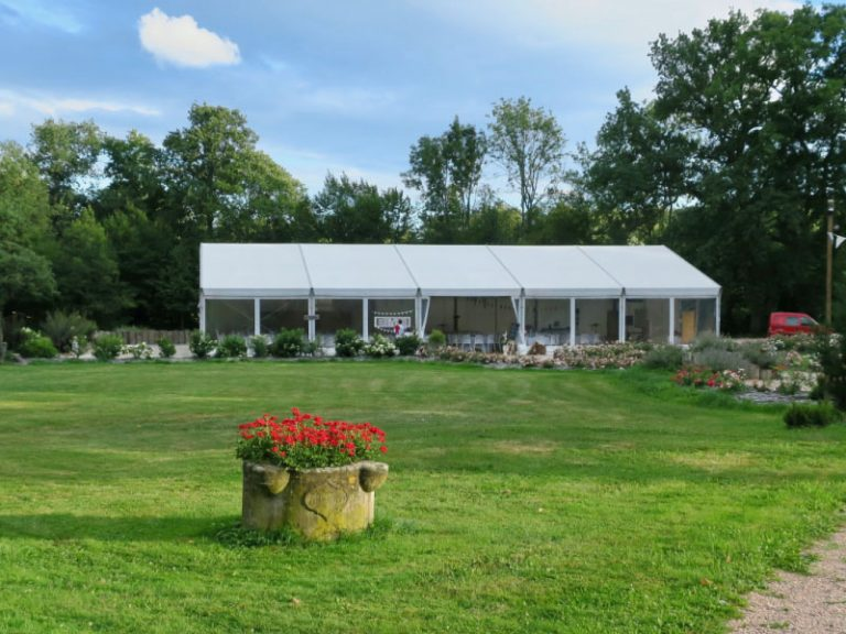 white marquee set in green surroundings