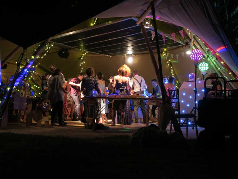 Crowded tipi dancefloor at event with Zone Array panels overhead