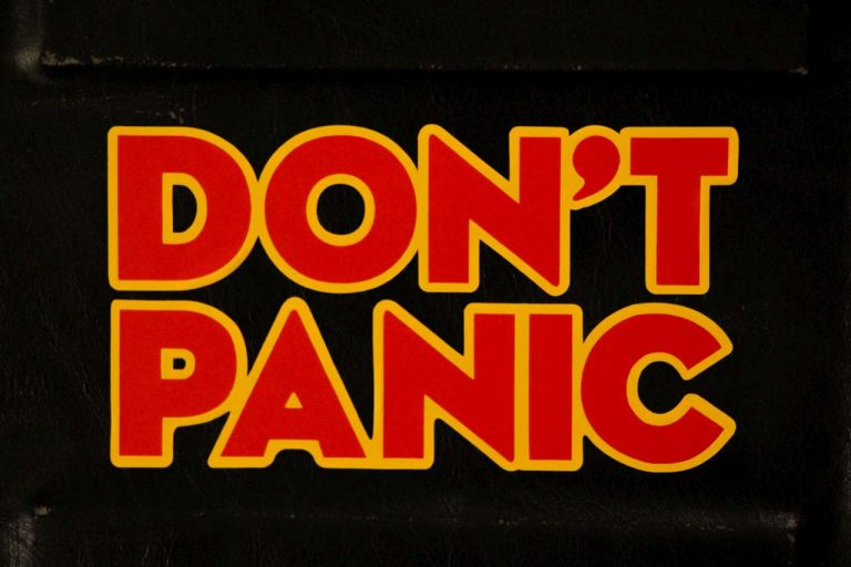 don't panic sign red on black background