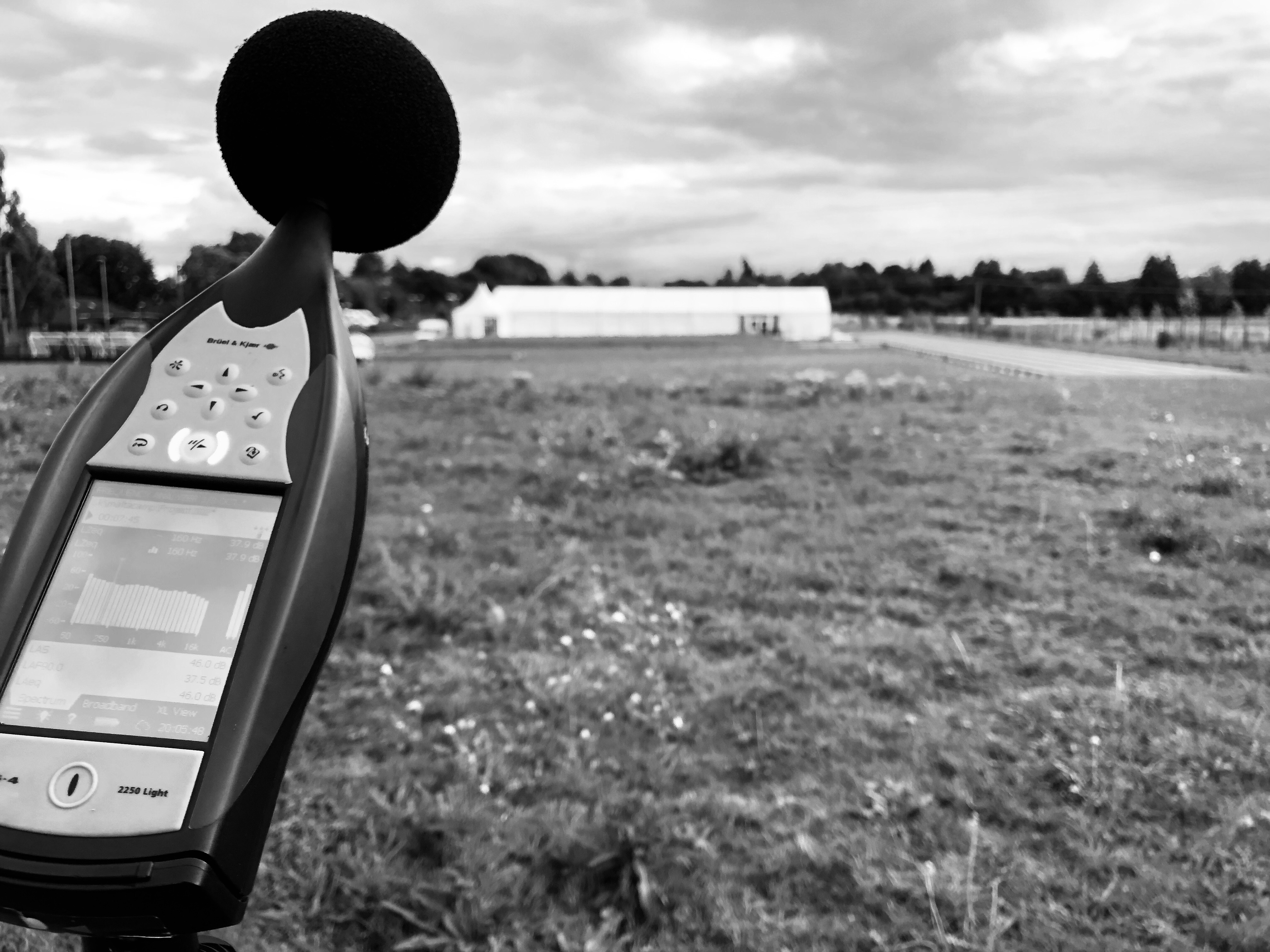 black and white sound reading device in foreground with blurred marquee in background