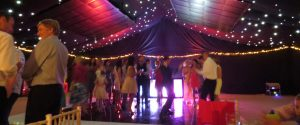 guests dancing on dancefloor in marquee