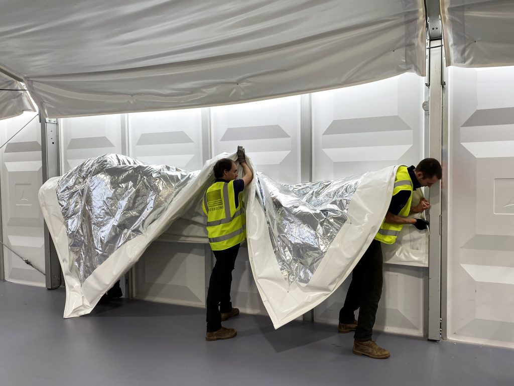 men soundproofing marquee with acoustic lining
