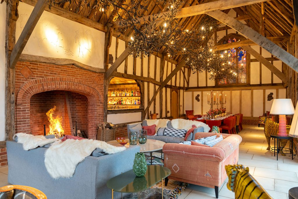 interior wooden beamed sitting room and dining with large fireplace